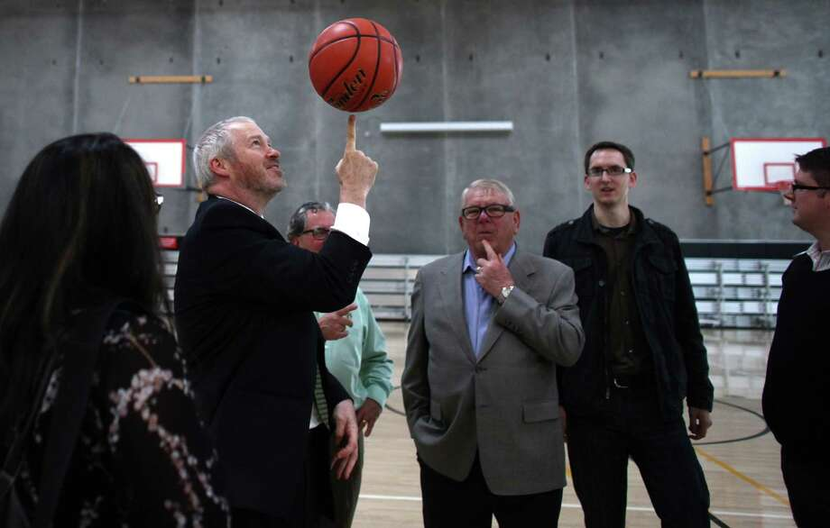October 16, 2012 — Seattle Mayor Mike McGinn spins a basketball after signing a law approving financing of a proposed NBA and NHL arena in Seattle's Sodo neighborhood at the Rainier Vista Boys and Girls Club. The City of Seattle and King County worked with investor Chris Hansen to hammer out a deal to build a new arena. Photo: JOSHUA TRUJILLO / SEATTLEPI.COM