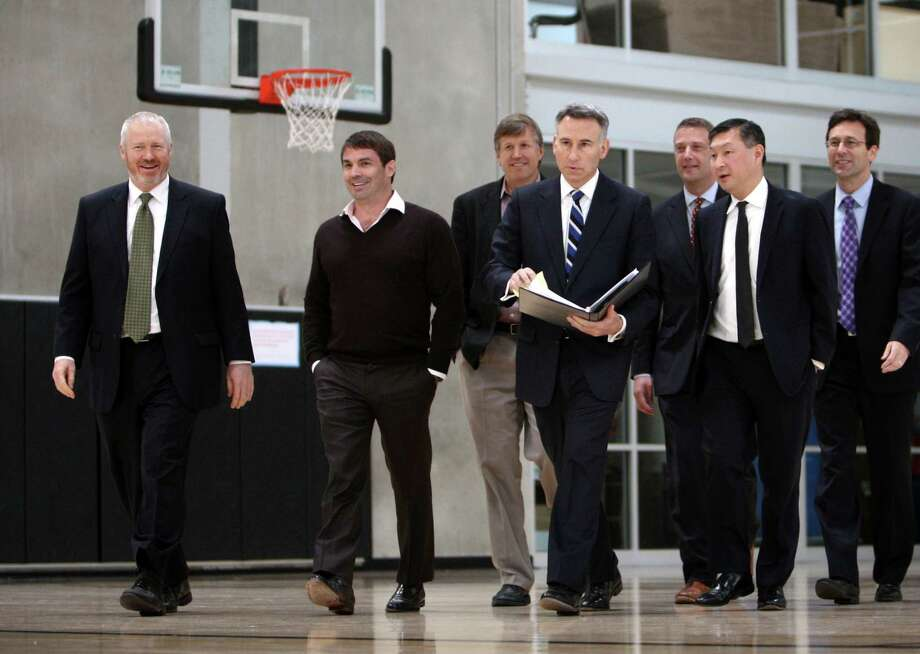 October 16, 2012— Officials, including Seattle Mayor Mike McGinn, left, investor Chris Hansen and King County Executive Dow Constantine, center, walk toward a ceremony to sign a law approving financing of a proposed NBA and NHL arena in Seattle's Sodo neighborhood at the Rainier Vista Boys and Girls Club. Photo: JOSHUA TRUJILLO / SEATTLEPI.COM