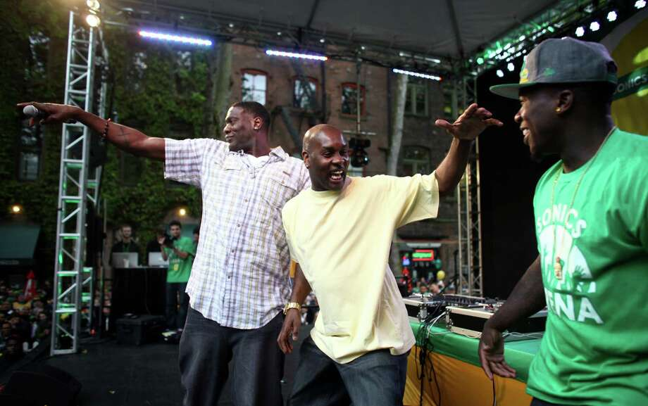 June 14, 2012— From left, Shawn Kemp, Gary Payton and Nate Robinson take the stage during a rally to bring back the Seattle SuperSonics. An estimated 6,000 people packed into Occidental Park to show support for bringing back the team. Photo: JOSHUA TRUJILLO / SEATTLEPI.COM