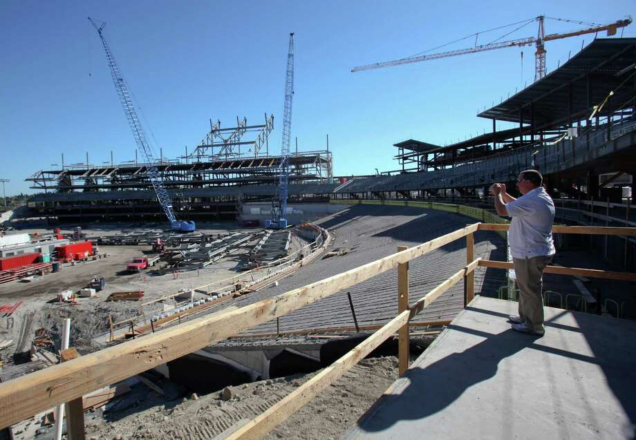 "August 24, 2012 — Radio host Dave ""Softy"" Mahler takes photos during a tour of the Husky Stadium construction site. The stadium is getting a significant upgrade and complete rebuild of the southern stands. The Huskies are playing at CenturyLink Field during the renovation. Photo: JOSHUA TRUJILLO / SEATTLEPI.COM"