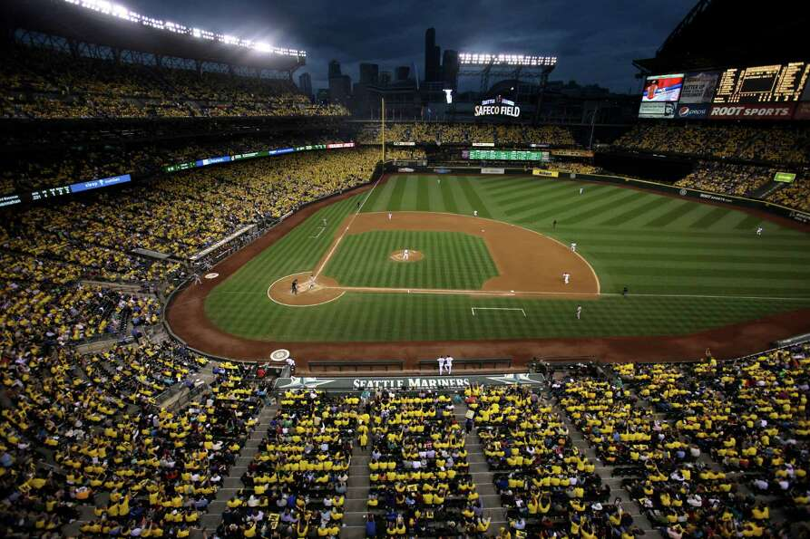 August 21, 2012 — Fans wear yellow shirts as Seattle Mariners pitcher Felix Hernandez takes