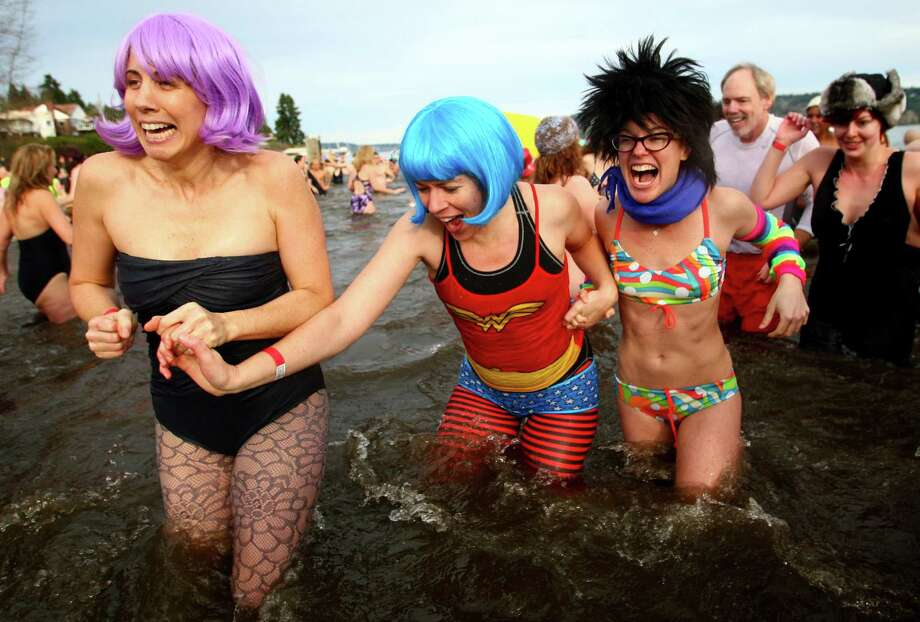 January 1, 2011— Participants brave the 49-degree Lake Washington water during the annual Polar Plunge at Matthews Beach in Seattle. The annual New Year tradition saw one of its largest turnouts as people waded, ran and dove into the cold water. Photo: JOSHUA TRUJILLO / SEATTLEPI.COM