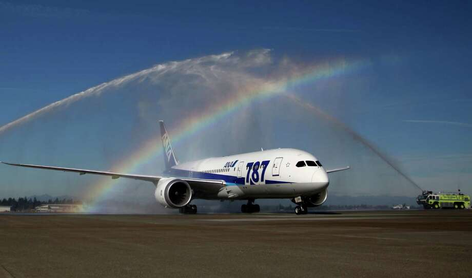 October 1, 2012 — An ANA 787 arrives to a turret salute by SeaTac pumper trucks at SeaTac International Airport. The plane was the first Boeing 787 commercial service to to the Seattle area. The 787 is assembled by Boeing in Everett. The ANA route had previously been served by a Boeing 777. Photo: JOSHUA TRUJILLO / SEATTLEPI.COM