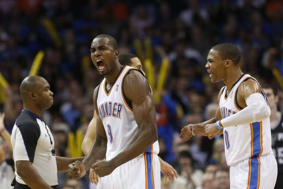Oklahoma City Thunder forward Serge Ibaka (9) and guard Russell Westbrook (0) react to a foul call against the San Antonio Spurs during an NBA basketball game in Oklahoma City, Monday, Dec. 17, 2012. Oklahoma City won 107-93.  (Sue Ogrocki / Associated Press)