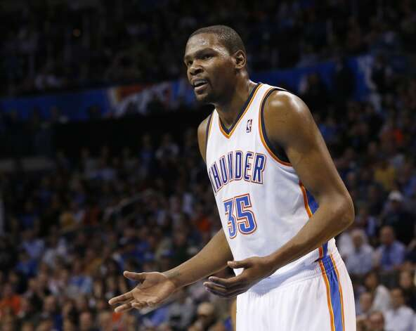 Oklahoma City Thunder forward Kevin Durant (35) questions an official during an NBA basketball game against the San Antonio Spurs in Oklahoma City, Monday, Dec. 17, 2012. Oklahoma City won 107-93.  (Sue Ogrocki / Associated Press)