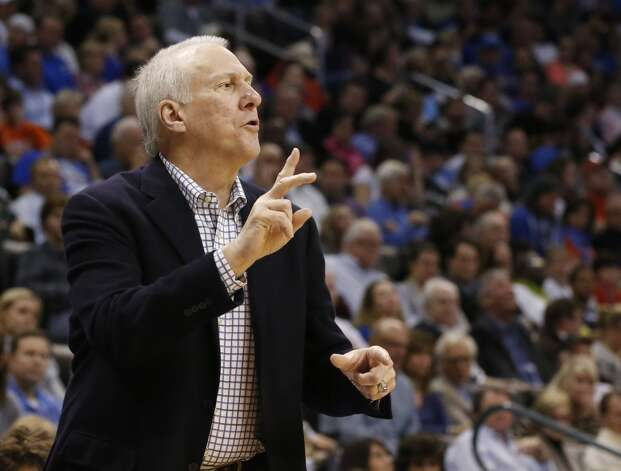 San Antonio Spurs head coach Greg Popovich gestures to his team during an NBA basketball game against the Oklahoma City Thunder in Oklahoma City, Monday, Dec. 17, 2012. Oklahoma City won 107-93.  (Sue Ogrocki / Associated Press)
