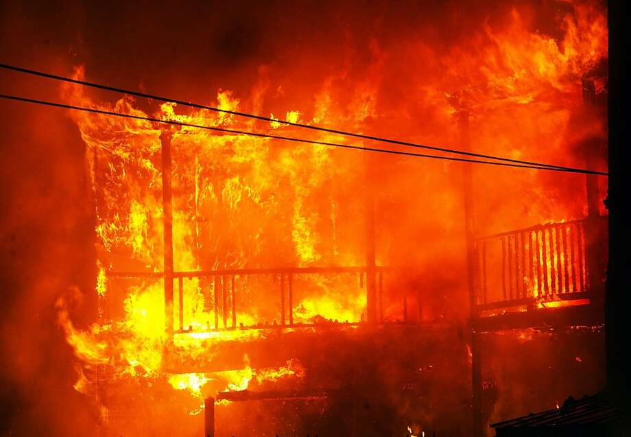The rear of two homes in the 500 block of West Princess Street in York that were fully involved with fire, Sunday Dec. 16, 2012.  More than 20 people have been displaced by a fire that damaged four residences in central Pennsylvania. Photo: Paul Kuehnel, Associated Press