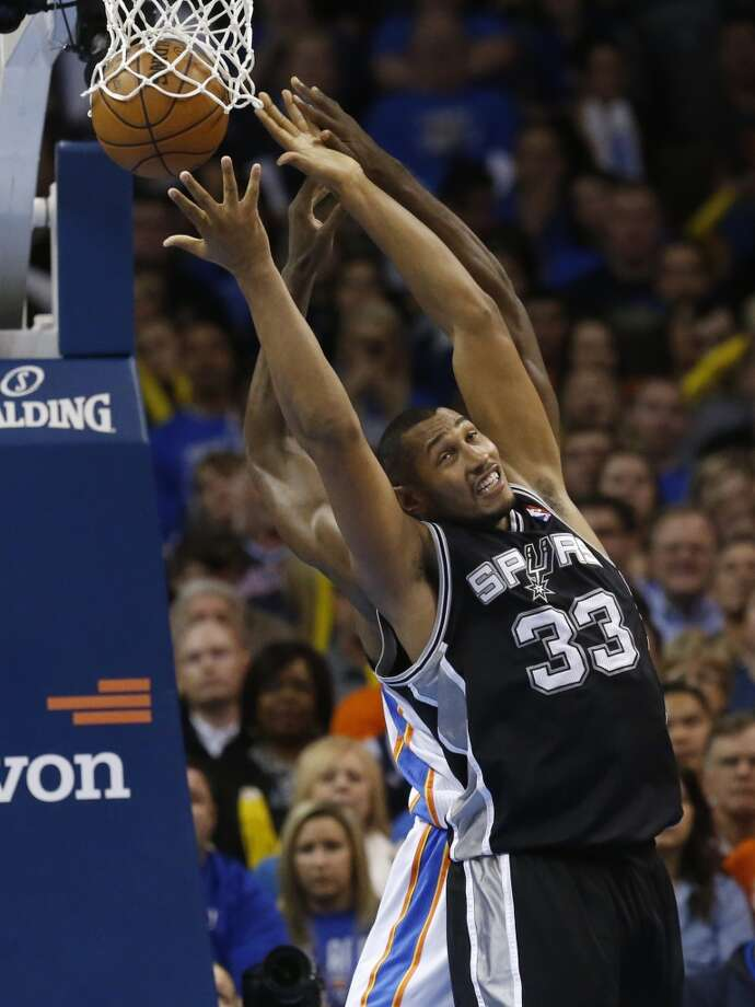 San Antonio Spurs forward Boris Diaw (33) reaches for a rebound during an NBA basketball game against the Oklahoma City Thunder in Oklahoma City, Monday, Dec. 17, 2012. Oklahoma City won 107-93. (Sue Ogrocki / Associated Press)
