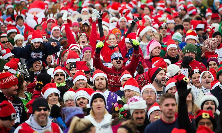Approximately 5,000 participants line up at the starting line for the ugly Christmas sweater 5K fun run Sunday, Dec. 16, 2012, in Omaha Neb. Photo: Rebecca S. Gratz, Associated Press