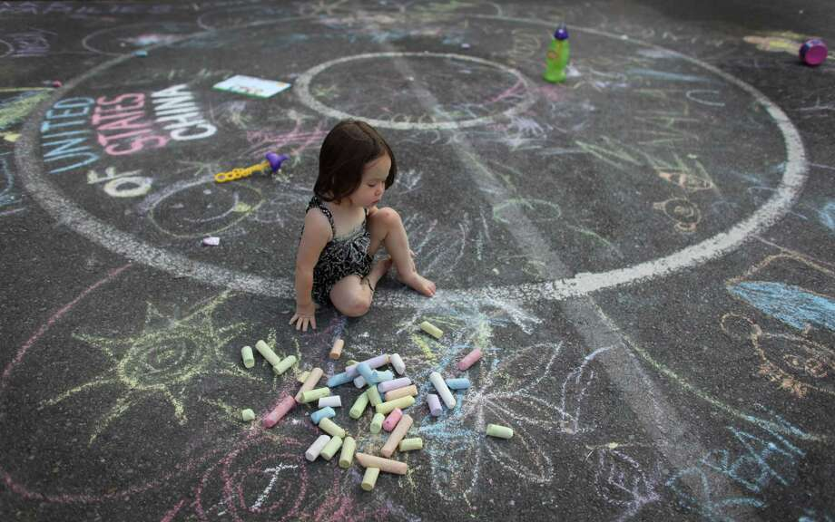 August 10, 2012— Rinka Chico, 2, works on her chalk art during the South Lake Union Block Party at the South Lake Union Discovery Center. Photo: JOSHUA TRUJILLO / SEATTLEPI.COM