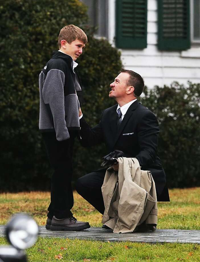 NEWTOWN, CT - DECEMBER 17:  A man comforts a boy outside Honan Funeral Home before the funeral for 6-year-old Jack Pinto on December 17, 2012 in Newtown Connecticut. Pinto was one of the 20 students killed in the Sandy Hook Elementary School mass shooting.  (Photo by Mario Tama/Getty Images) *** BESTPIX *** Photo: Mario Tama, Getty Images