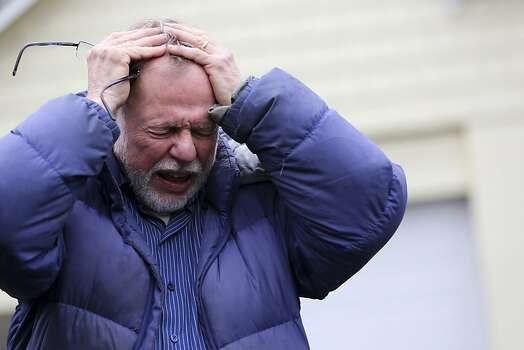 Gene Rosen becomes emotional as he describes, in an interview with The Associated Press, Monday, Dec. 17, 2012, that after Friday's shooting at Sandy Hook Elementary School, he took in six students who were sitting at the end of his driveway who had just run from the school to escape the deadly massacre. Rosen ran upstairs and grabbed an armful of stuffed animals he kept there. He gave those to the children, along with some fruit juice and sat with them as two of the students described seeing their teacher being shot. (AP Photo/Mary Altaffer) Photo: Mary Altaffer, Associated Press