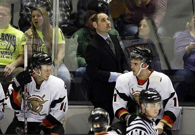 Bulls coach Pat Curcio looks up at the scoreboard during the second period of a 6-4 loss to the Stockton Thunder on Dec. 17. The team's merchandise sales are better than their record. Photo: Carlos Avila Gonzalez, The Chronicle