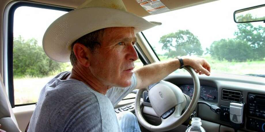 Bush drives his pickup truck at his ranch in Crawford, Texas in 2002. (ERIC DRAPER / AP PHOTO/THE WHITE HOUSE)