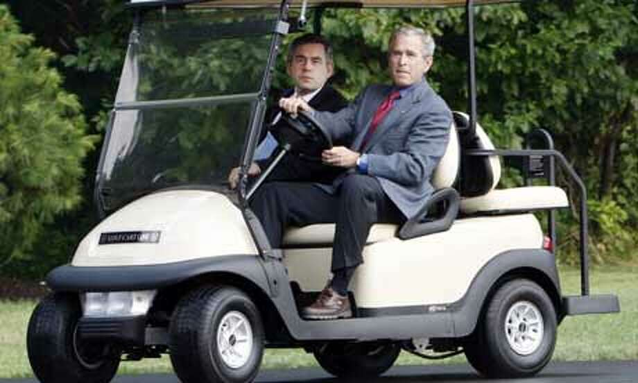 President George Bush drives British prime minister Gordon Brown in a golf cart after welcoming him to the presidential retreat at Camp David.  (Charles Dharapak / AP Photo)