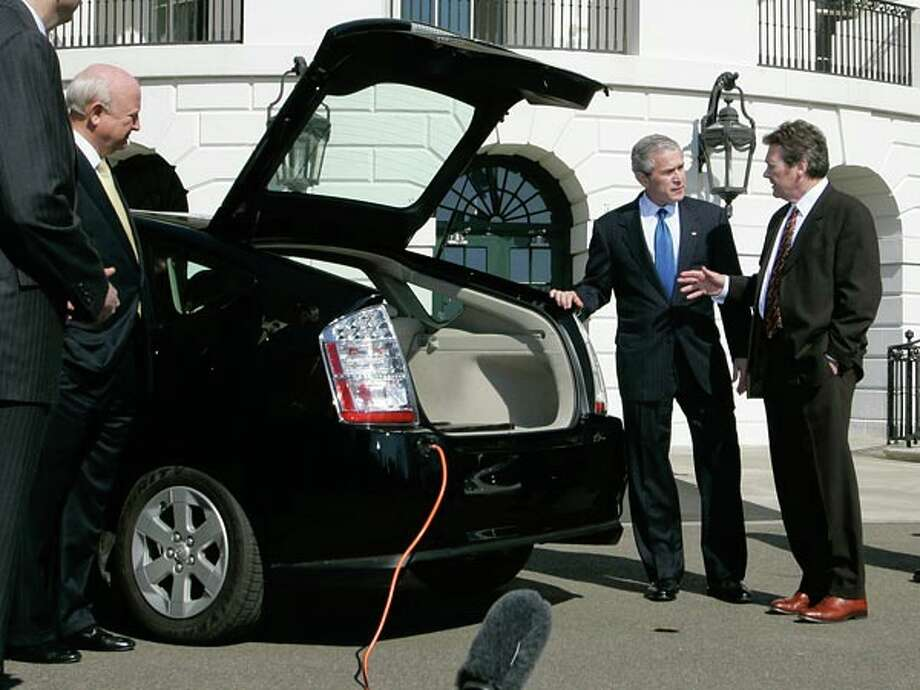 A123 Systems, which makes battery techonology such as the lithium ion cells for hybrid vehicle pictured below, received a $6 million grant from the Bush administration in 2007 and a $249 million grant from the Obama administration in 2009. A123 CEO David Vieau is shown above with President Bush in 2007. (Charles Dharapak / AP Photo)