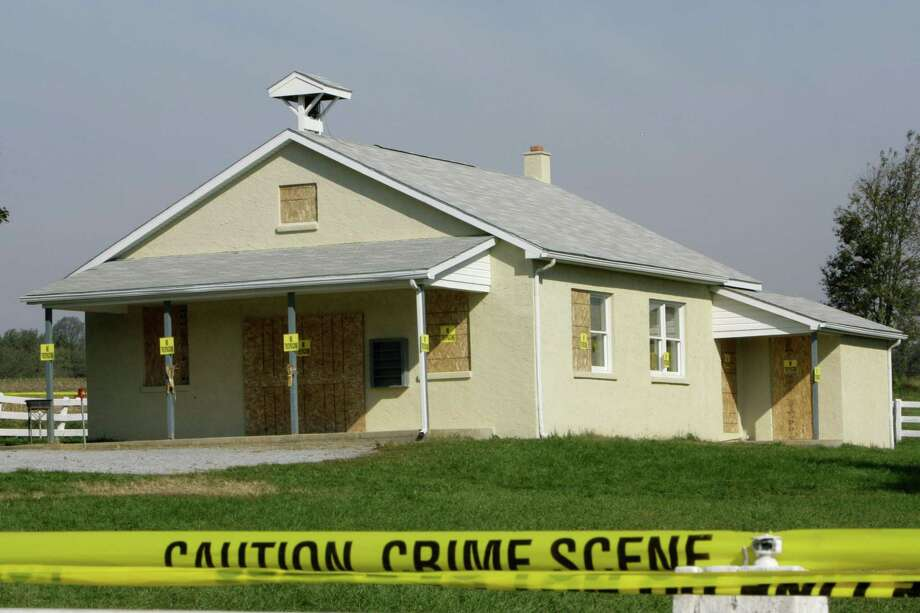 Crime scene tape is seen surrounding the boarded-up schoolhouse in Nickel Mines, Pa., Oct. 4, 2006 where a milk truck driver stormed the one-room Amish schoolhouse, sent the boys and adults outside, barricaded the doors with two-by-fours, and then opened fire on several girls before committing suicide. Five girls died.  Photo: MATT ROURKE, AP / AP