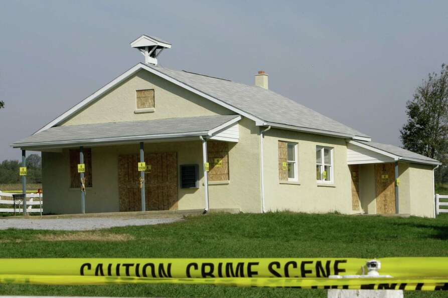 Crime scene tape is seen surrounding the boarded-up schoolhouse in Nickel Mines, Pa., Oct. 4, 2006 w