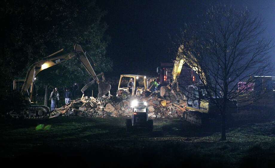 The Amish school in Nickel Mines, Pa., where a gunman shot 10 girls in 2006, killing five of them, is demolished by private contractors before dawn Thursday, Oct. 12, 2006. Photo: MATT ROURKE, AP / AP