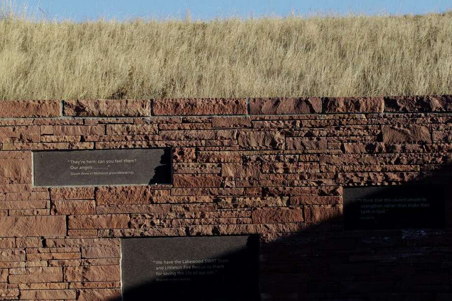 Engraved marble plaques at a memorial bear quotes related to the 1999 shootings at Columbine High School, in Littleton, Colo., Monday Dec. 17, 2012. Columbine and other sites of mass shootings have been rebuilt by residents determined to reclaim public places invaded by gunmen. Deciding what to do with the scene of a tragic event often determines how a community will heal. (AP Photo/Brennan Linsley) Photo: Brennan Linsley, Associated Press / AP