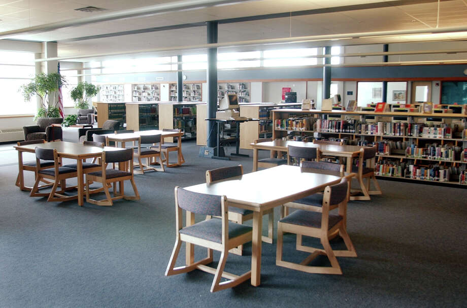 "This April 14, 2004 file photo shows  the New Hope Memorial Columbine Library at Columbine High School in Littleton, Colo. The old library where a majority of students were killed was torn down. After the massacre at Columbine, students finished the year at another school. Columbine reopened in time for the following school year after extensive repairs.""The intent of the school district is to put this back as a high school,"" Jack Swanzy, lead architect on the refurbishing project, said at the time. ""We don't want to make it a shrine to the tragedy."" (AP Photo/Ed Andrieski, File) Photo: Ed Andrieski, Associated Press / AP"