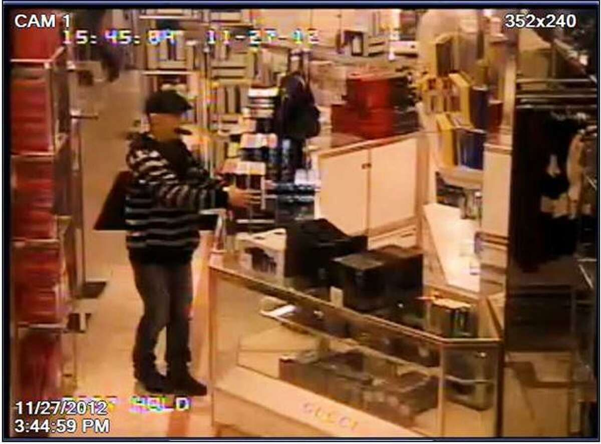 Police have released images of a syringe-wielding robber who threatened a Macy's employee after stealing boxes of cologne from the store at Rivercenter Mall.