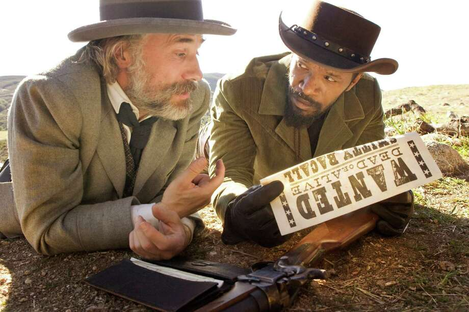 "FILE - This undated publicity image released by The Weinstein Company shows, from left, Christoph Waltz as Schultz and Jamie Foxx as Django in ""Django Unchained,"" directed by Quentin Tarantino. In Los Angeles, the Weinstein Co. canceled Tuesday, Dec. 18, 2012, planned premiere of the violent movie ""Django Unchained."" Photo: The Weinstein Company, Andrew Cooper, SMPSP"