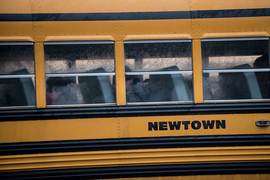 A school bus takes students to Newtown High School December 18, 2012 in Newtown, Connecticut. Studen
