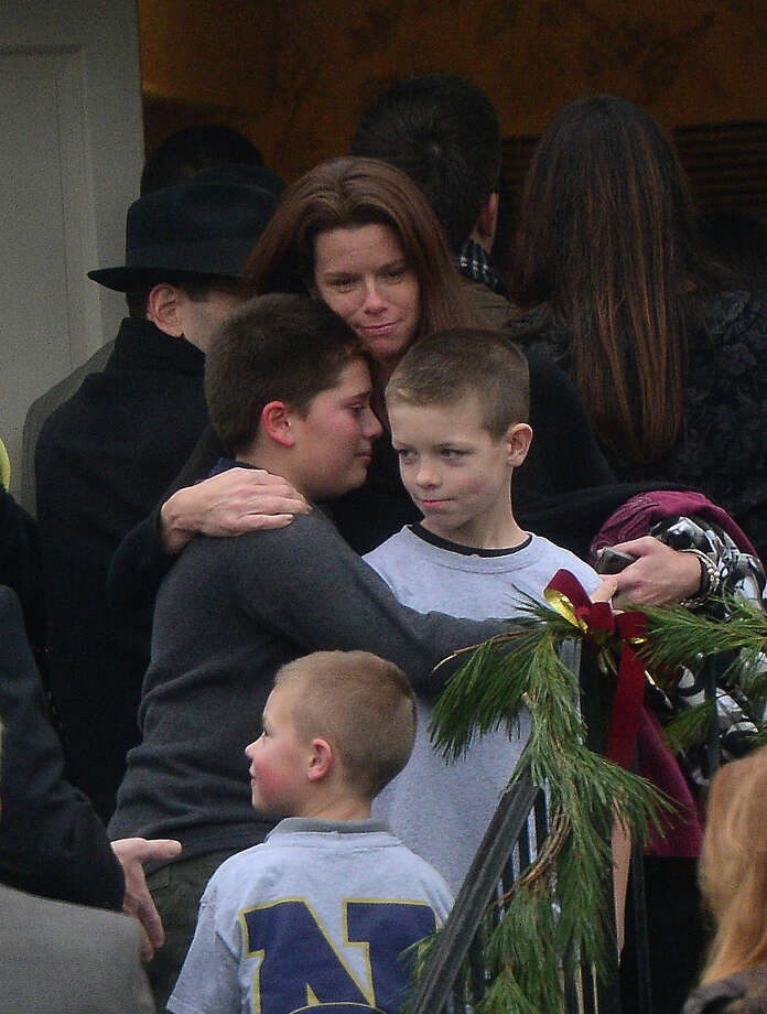 Young mourners arrive at Honan funeral home to attend the funeral for Jack Pinto, 6, one of the victims of the Sandy Hook elementary school shooting, on December 17, 2012, in Newtown, Connecticut. Funerals began in the little Connecticut town of Newtown after the school massacre that took the lives of 20 small children and six staff, triggering new momentum for a change to America's gun culture. AFP PHOTO/Emmanuel DUNAND Photo: EMMANUEL DUNAND, AFP/Getty Images / 2012 AFP