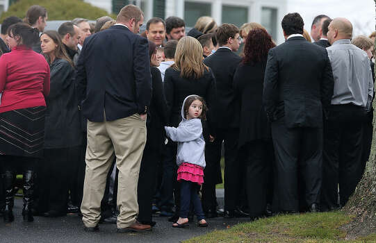 NEWTOWN, CT - DECEMBER 17:  A girl looks on as mourners wait to enter Honan Funeral Home before the funeral for 6-year-old Jack Pinto on December 17, 2012 in Newtown Connecticut. Pinto was one of the 20 students killed in the Sandy Hook Elementary School mass shooting. Photo: Mario Tama, Getty Images / 2012 Getty Images