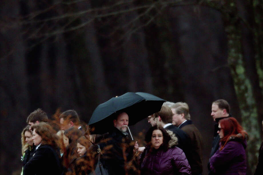 MONROE, CT - DECEMBER 17:  People attend the funeral services for six year-old Noah Pozner, who was  killed in the shooting massacre in Newtown, CT, at B'nai Israel Cemetery on December 17, 2012 in Monroe, Connecticut. Today is the first day of funerals for some of the twenty children and seven adults who were killed by 20-year-old Adam Lanza on December 14, 2012. Photo: Spencer Platt, Getty Images / 2012 Getty Images