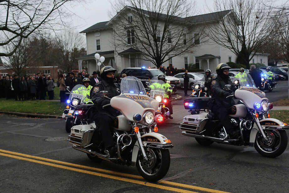 FAIRFIELD, CT - DECEMBER 17:  Police on motorcycles escort the hearse following the funeral services for six year-old Noah Pozner, who was  killed in the shooting massacre in Newtown, CT, at Abraham L. Green and Son Funeral Home on December 17, 2012 in Fairfield, Connecticut. Today is the first day of funerals for some of the twenty children and seven adults who were killed by 20-year-old Adam Lanza on December 14, 2012. Photo: Spencer Platt, Getty Images / 2012 Getty Images