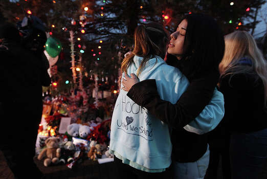 NEWTOWN, CT - DECEMBER 17:  People hug at a memorial for victims of the mass shooting at Sandy Hook Elementary School, on December 17, 2012 in Newtown, Connecticut. The first two funerals for victims of the shooting were held today. Photo: Mario Tama, Getty Images / 2012 Getty Images