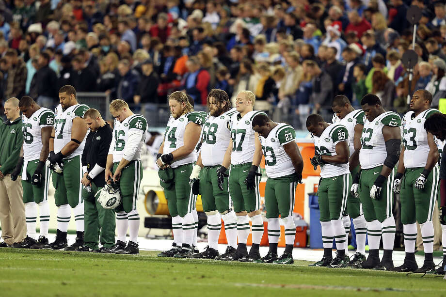 NASHVILLE, TN - DECEMBER 17:  The New York Jets stand on the sideline in a moment in silence for the victims of the mass shooting that took place at Sandy Hook elementary school in Newtown, Connecticut prior to the game against the Tennessee Titans at LP Field on December 17, 2012 in Nashville, Tennessee. Photo: Andy Lyons, Getty Images / 2012 Getty Images
