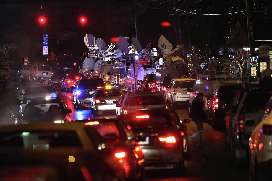 NEWTOWN, CT - DECEMBER 17:  Television trucks and traffic crowd a memorial on December 17, 2012 in Newtown, Connecticut. Twenty children and six adults were reportedly killed by Adam Lanza, after he entered the school and opened fire. The massacre was the second-deadliest school shooting in the United States after the 2007 Virginia Tech shooting. He reportedly killed his mother Nancy Lanza at their  Newtown home before driving to the school. After shooting the students and employees, he committed reportedly committed suicide. Photo: John Moore, Getty Images / 2012 Getty Images