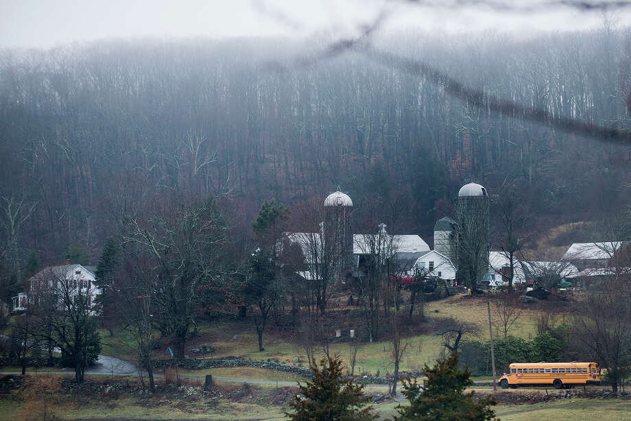 A school bus drives past a farm while picking up students December 18, 2012 in Newtown, Connecticut. Students in Newtown, excluding Sandy Hook Elementary School, return to school for the first time since last Friday's shooting at Sandy Hook which took the live of 20 students and 6 adults.  AFP PHOTO/Brendan SMIALOWSKI Photo: BRENDAN SMIALOWSKI, AFP/Getty Images / 2012 AFP