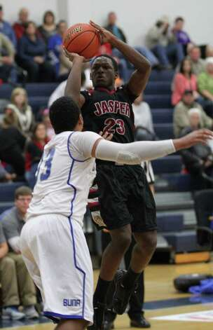 Demarcus Collins goes up for a jumper against Buna. Photo: Jason Dunn