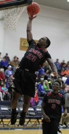 Demarcus Collins goes in for an uncontest layup against Buna. Photo: Jason Dunn