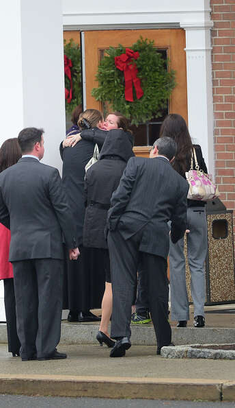 Mourners attend the funeral services of James Mattioli, 6  at Saint Rose of Lima Church on December