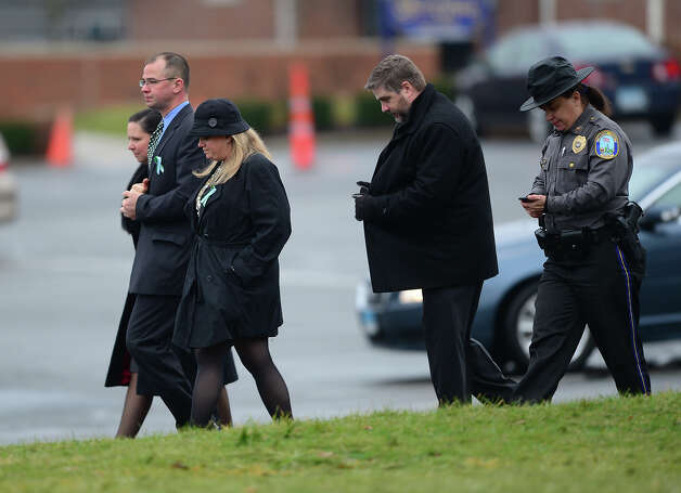 Mourners attend the funeral services of James Mattioli, 6  at Saint Rose of Lima Church on December 18, 2012 in Newtown, Connecticut.  Lawmakers are under mounting pressure to address the issue of gun laws in the aftermath of last week's school massacre in Newtown, Connecticut. AFP PHOTO/EMMANUEL DUNAND Photo: EMMANUEL DUNAND, AFP/Getty Images / 2012 AFP