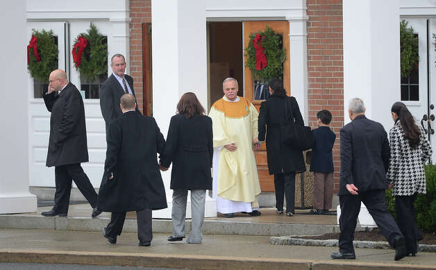 Mourners arrive to attend the funeral services of James Mattioli, 6  at Saint Rose of Lima Church on December 18, 2012 in Newtown, Connecticut.  Lawmakers are under mounting pressure to address the issue of gun laws in the aftermath of last week's school massacre in Newtown, Connecticut. AFP PHOTO/EMMANUEL DUNAND Photo: EMMANUEL DUNAND, AFP/Getty Images / 2012 AFP