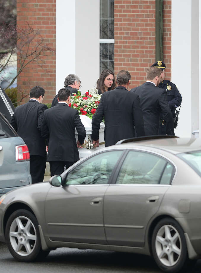 The casket for the funeral service of James Mattioli, 6 is carried into Saint Rose of Lima Church on December 18, 2012 in Newtown, Connecticut.  Lawmakers are under mounting pressure to address the issue of gun laws in the aftermath of last week's school massacre in Newtown, Connecticut. AFP PHOTO/EMMANUEL DUNAND Photo: EMMANUEL DUNAND, AFP/Getty Images / 2012 AFP