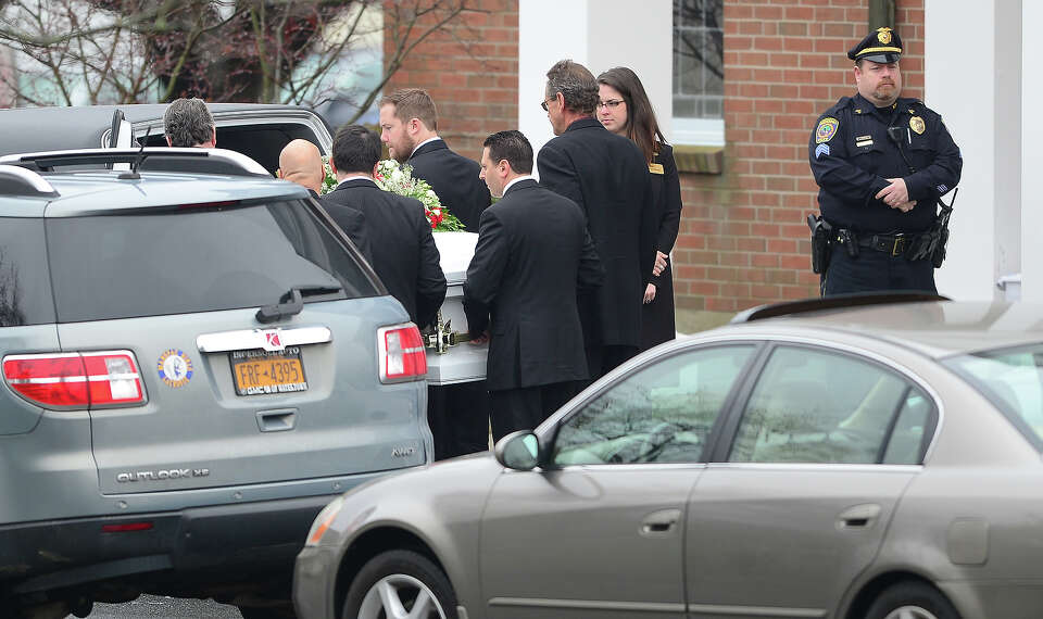 The casket for the funeral service of James Mattioli, 6 arrives at Saint Rose of Lima Church on Dece