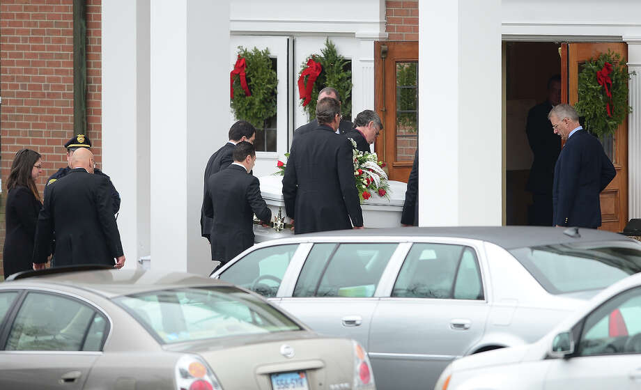 The casket of James Mattioli, 6 is carried into Saint Rose of Lima Church on December 18, 2012 in Newtown, Connecticut.  Lawmakers are under mounting pressure to address the issue of gun laws in the aftermath of last week's school massacre in Newtown, Connecticut. AFP PHOTO/EMMANUEL DUNAND Photo: EMMANUEL DUNAND, AFP/Getty Images / 2012 AFP