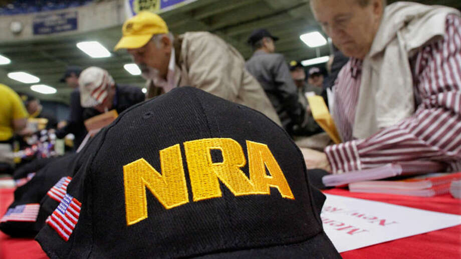 Illinois gun owners and supporters fill out NRA applications while participating in an Illinois Gun Owners Lobby Day convention Wednesday, March 7, 2012 in Springfield, Ill.  (Seth Perlman / AP Photo)