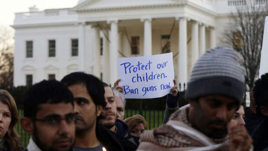 Supporters of gun control gather on Pennsylvania Avenue in front of the White House in Washington on Friday, during a vigil for the victims of the shooting at Sandy Hook Elementary School in Newtown, Ct., and to call on President Obama to pass strong gun control laws. (Charles Dharapak / AP Photo)