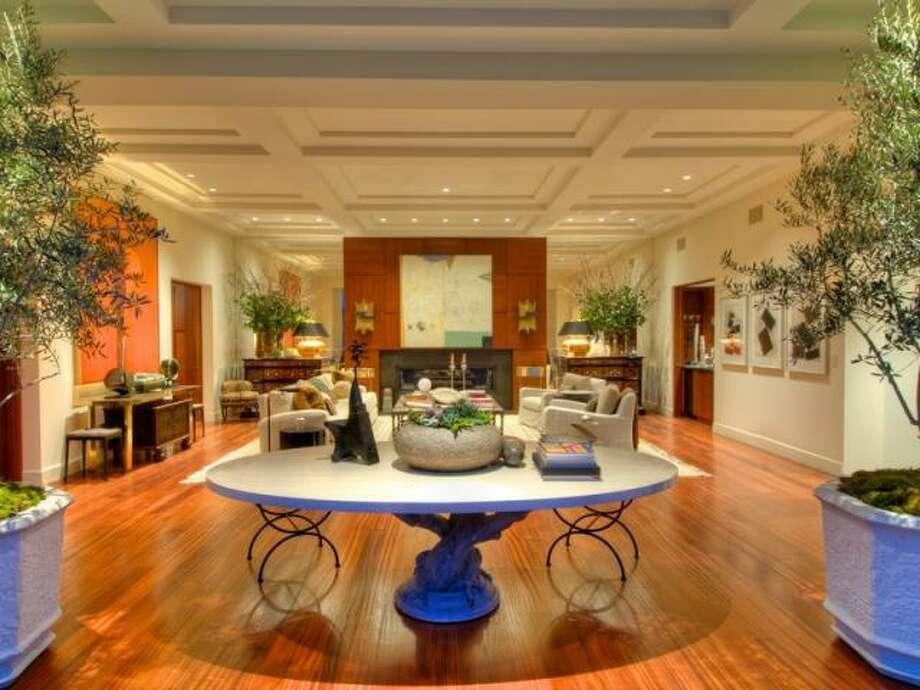 The living room has Sapele (African Mahogany) hardwood floors. (Olivia Hsu Decker)