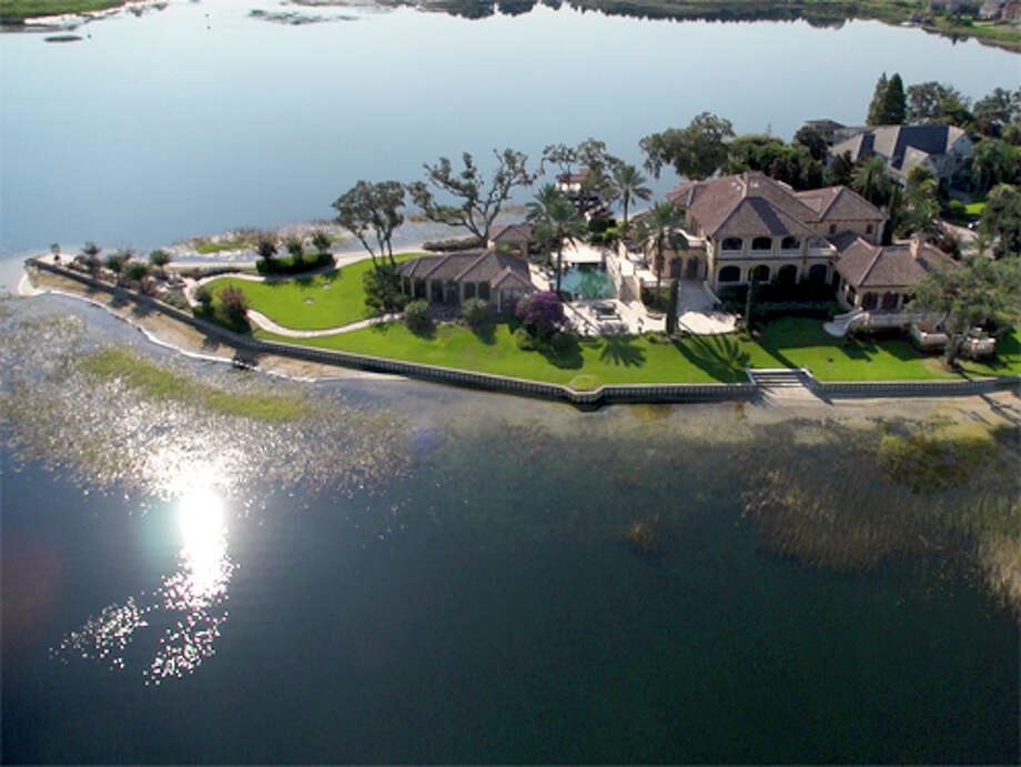 The Windermere property is surrounded on three sides by water. (DeCaro Real Estate Auctions)