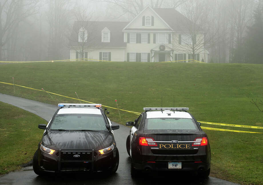 Police are positioned outside the home of Nancy Lanza  December 18, 2012 in Newtown, Connecticut.  Nancy Lanza was killed by her son Adam before going on his rampage at Sandy Hook Elementary School on December 14, 2012. AFP PHOTO/DON EMMERT Photo: DON EMMERT, AFP/Getty Images / 2012 AFP