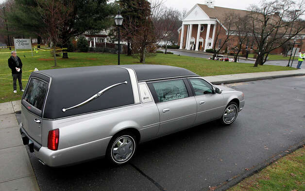 A hearse arrives at St. Rose of Lima Roman Catholic Church during funeral services for James Mattioli,Tuesday, Dec. 18, 2012, in Newtown, Conn. Mattioli, 6, was killed when Adam Lanza walked into Sandy Hook Elementary School in Newtown, Conn., Dec. 14,  and opened fire, killing 26 people, including 20 children, before killing himself. Photo: AP
